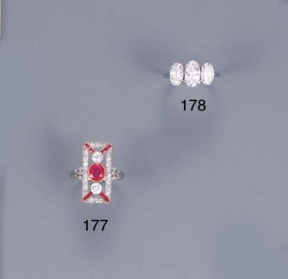 A DIAMOND THREE-STONE RING, BY