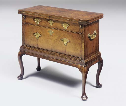 A WALNUT BACHELOR'S CHEST-ON-S