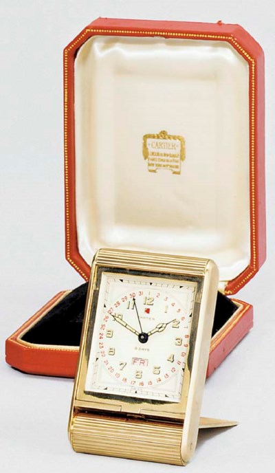 A Swiss gold travelling clock