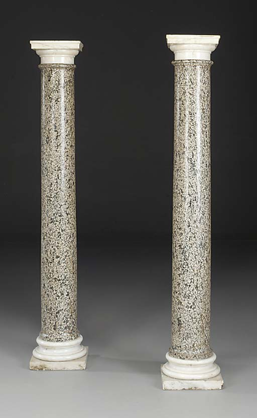 A PAIR OF CYLINDRICAL GRANITE