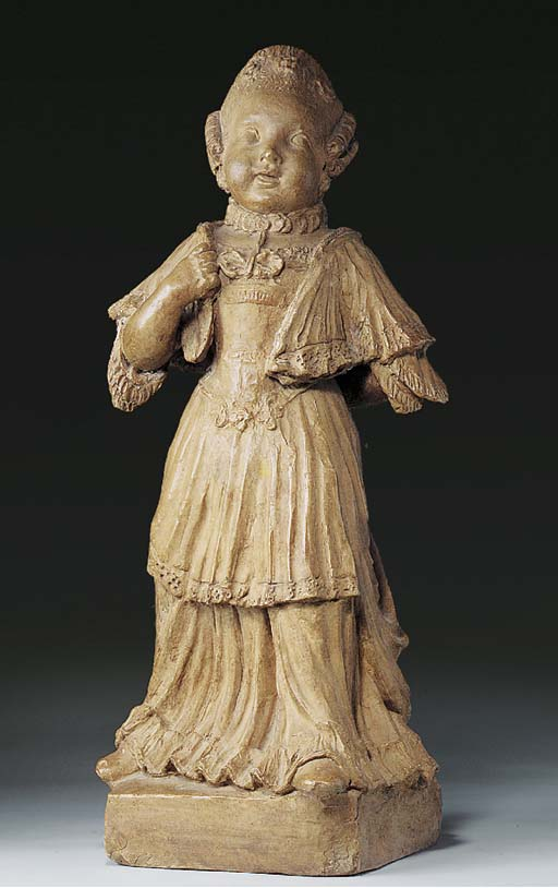 A TERRACOTTA FIGURE OF A GIRL
