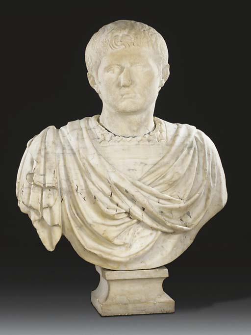 A CARVED MARBLE BUST OF AUGUST