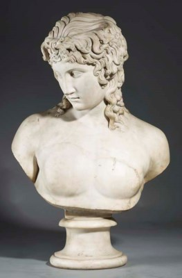 A CARVED MARBLE BUST OF EROS