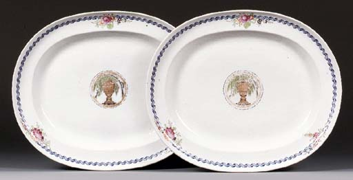A PAIR OF LARGE FAMILLE ROSE 'L'URNE MYSTERIEUSE' OVAL DISHES