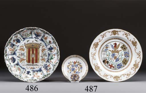 A FAMILLE VERTE ARMORIAL MOULDED SAUCER-DISH