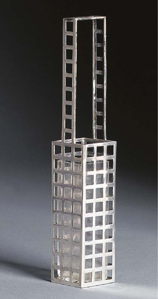 A pierced silver vase
