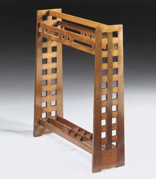 A mahogany towel rail