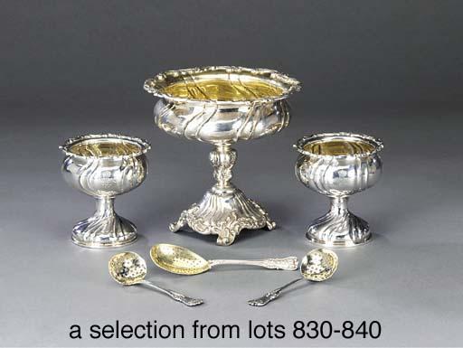 A pair of German silver sugar-