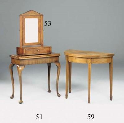 A mahogany demi-lune tea table