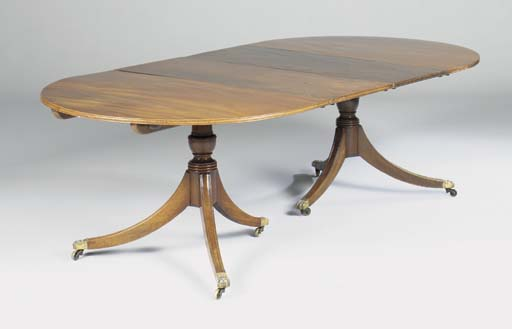 A mahogany twin pedestal dining table, 20th century including earlier parts