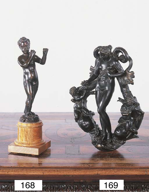 A BRONZE FIGURE OF A MUSIC MAKING PUTTO