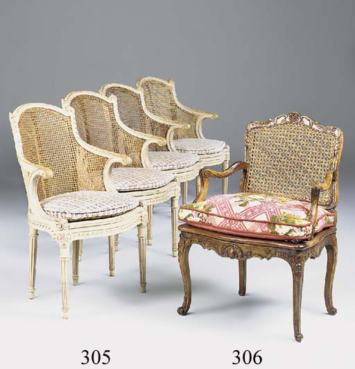 A WALNUT AND CANED FAUTEUIL, 19TH CENTURY