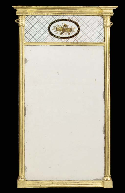 A REGENCY GILTWOOD AND VERRE EGLOMISE MIRROR
