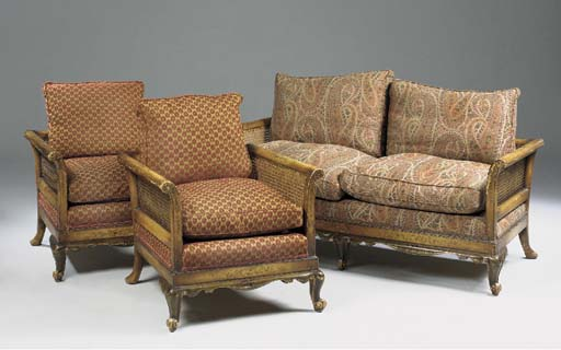 A YELLOW JAPANNED AND PARCEL GILT BERGERE THREE PIECE SUITE, EARLY 20TH CENTURY
