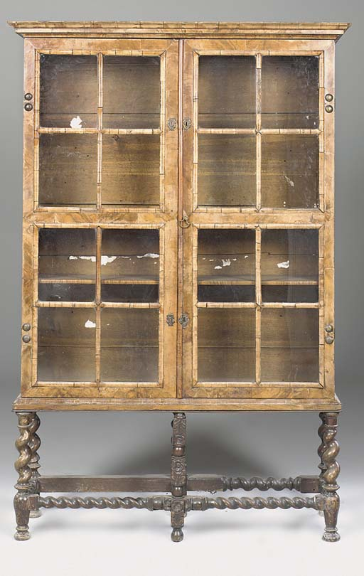 A walnut glazed cabinet on stand, late 19th early 20th century