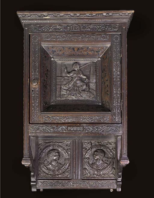 AN OAK CARVED DOLE CUPBOARD, 19TH CENTURY INCORPORATING 16TH AND 17TH CENTURY PANELS