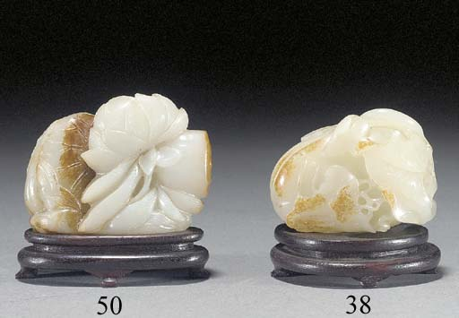 A pale celadon and russet jade carving of a melon 18th/19th Century