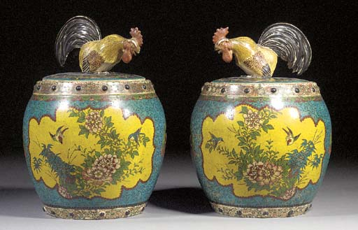 A pair of Japanese cloisonne on porcelain barrel-shaped jars and covers 19th century