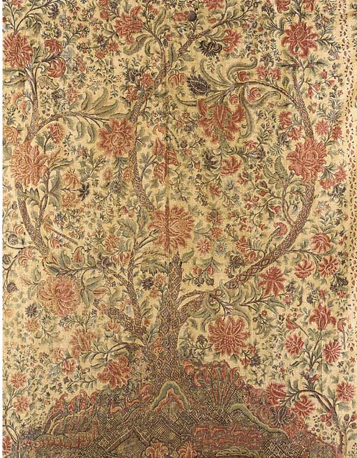 A Palampore, finely printed and painted with a flamboyant tree, the bark textured with a stylised diapered pattern on hillocky ground, housing flocks of deer and elegant pheasants, the vertical borders with miniature trees and oversized flowers, lined and edged with woven ribbon--96 x 102in. (240 x 255cm.), some wear to the left border