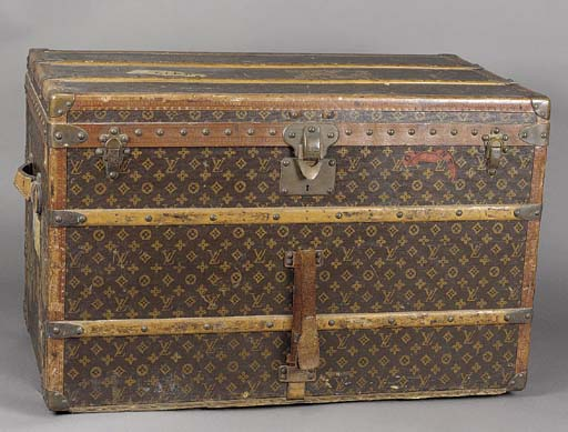 A Louis Vuitton trunk, covered in LV monogram canvas and bound in leather and brass with wooden bandings, the sides initialled M.P. in red, the lid interior with ivory ribbon lattice, labelled LOUIS VUITTON PARIS LONDON NICE CANNES VICHY 779347--36 X 21 X 23in. (90 x 52 x 57cm.), lacks tray, some wear, circa 1920