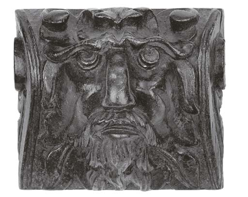 A relief carved oak green man corbel english th