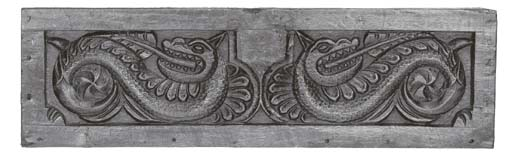 A relief carved oak panel, Eng