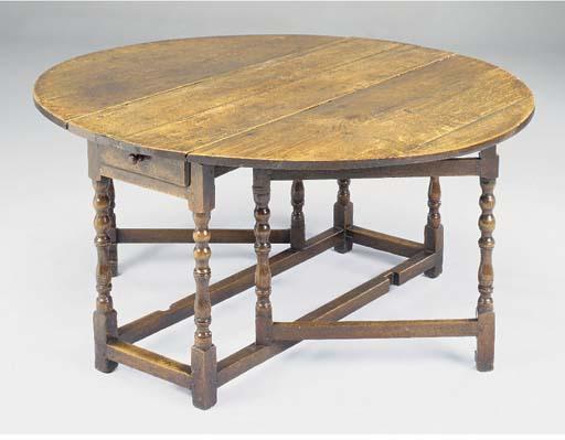 AN OAK GATELEG TABLE, ENGLISH,