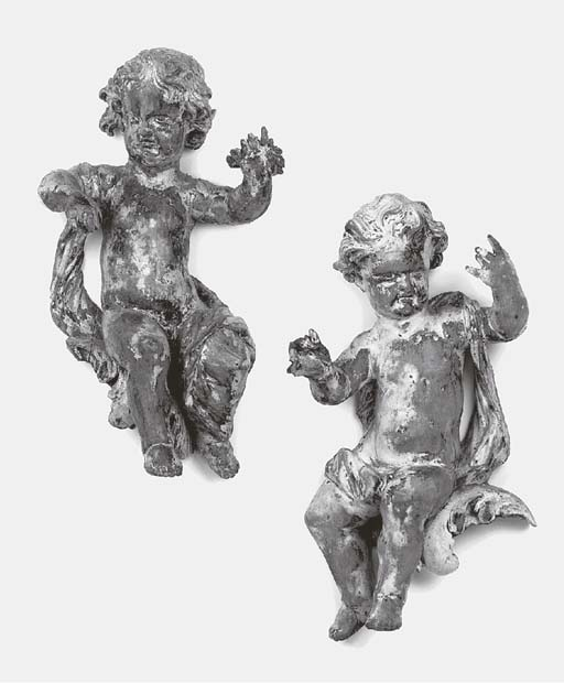 A pair of Flemish carved limew