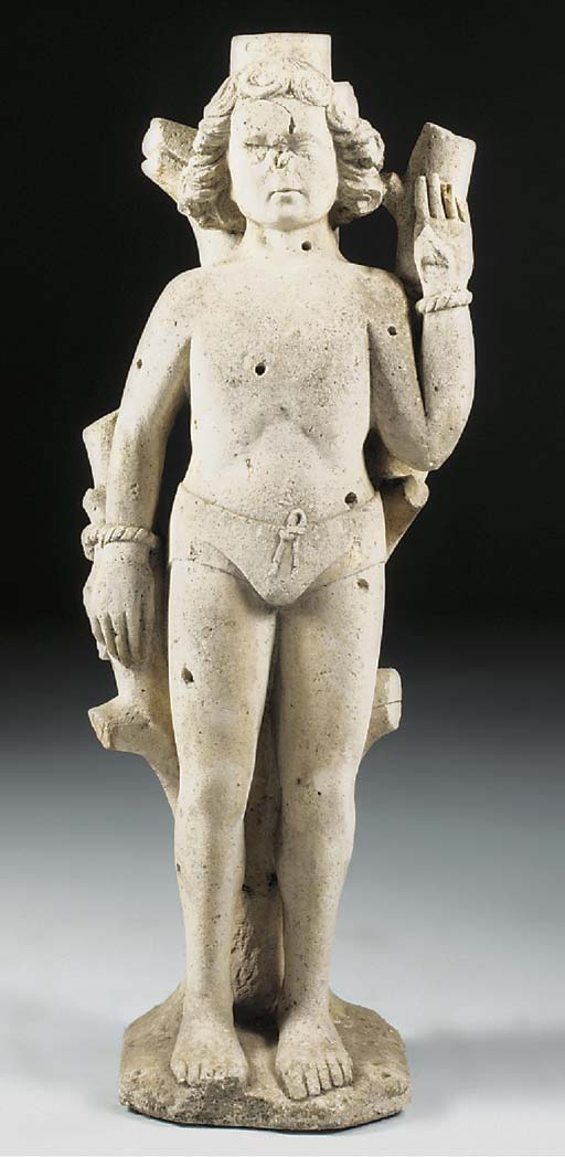 A carved limestone figure of S