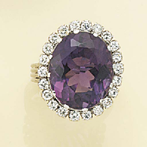 An amethyst and diamond cluste