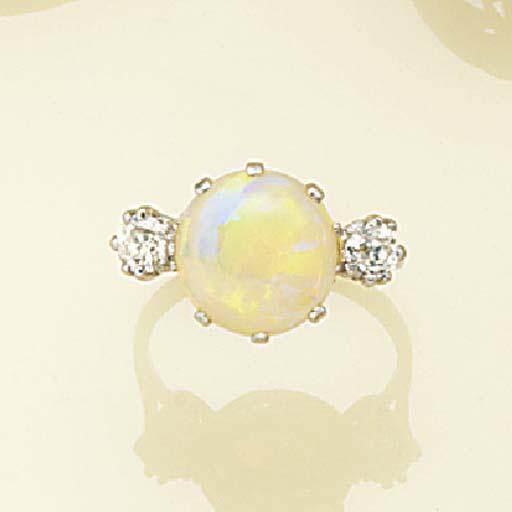 An opal and diamond three ston