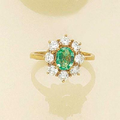 An emerald and diamond oval cl