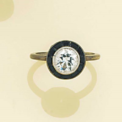 A diamond and onyx ring,
