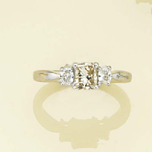 A princess-cut diamond and ova