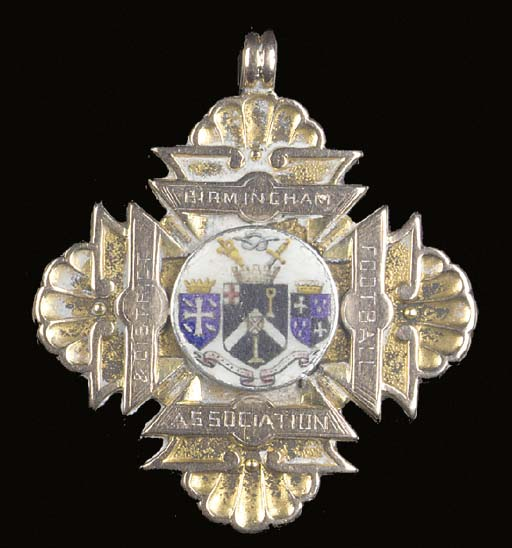 A 12ct gold and enamel medal,