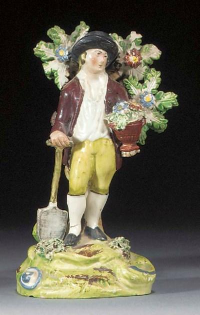 A Walton figure of a gardener