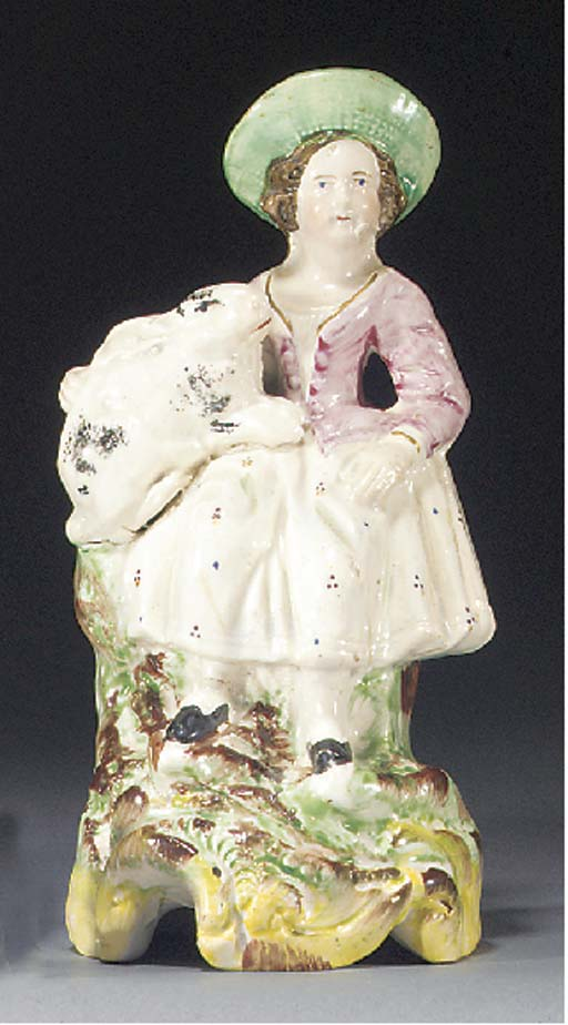 A figure of a girl and bunny