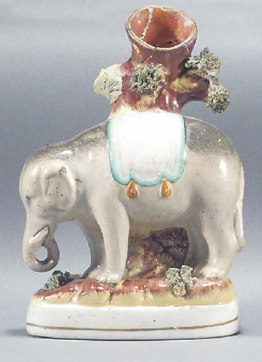 An elephant spill vase