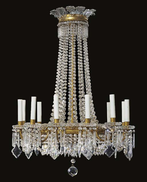 A French glass and gilt bronze twelve light chandelier, first half 20th centur