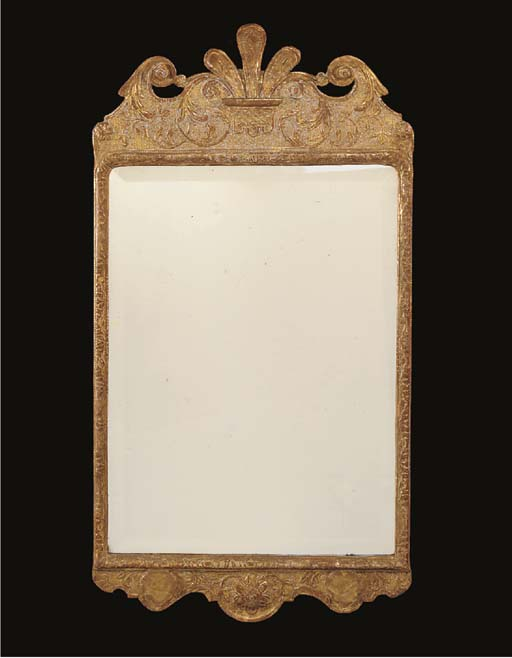 A GEORGE I GILT AND GESSO WALL MIRROR