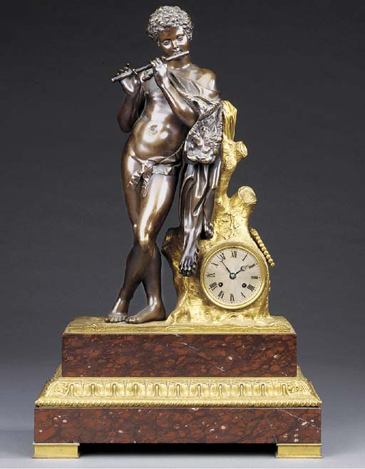 A Napoleon III gilt and patinated bronze mantel clock