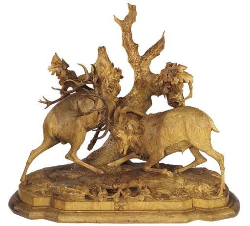A carved wood and stained wood group of two stags, circa 1890