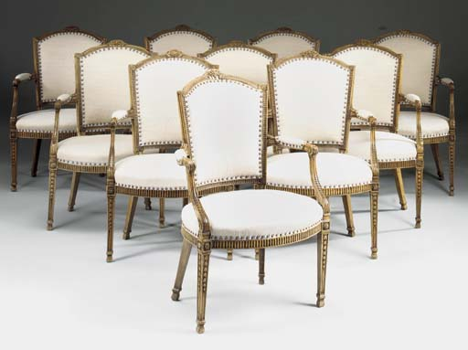 A SET OF TEN FRENCH BEECHWOOD OPEN ARMCHAIRS, 19TH CENTURY, IN THE LOUIS XVI STYLE