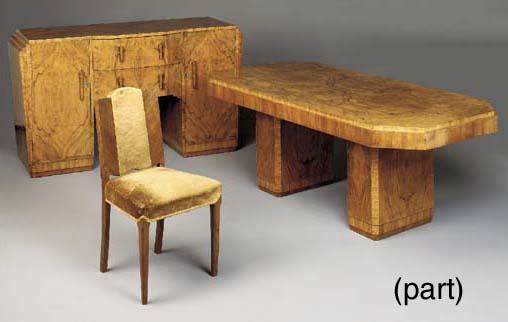 AN ENGLISH WALNUT DINING SUITE