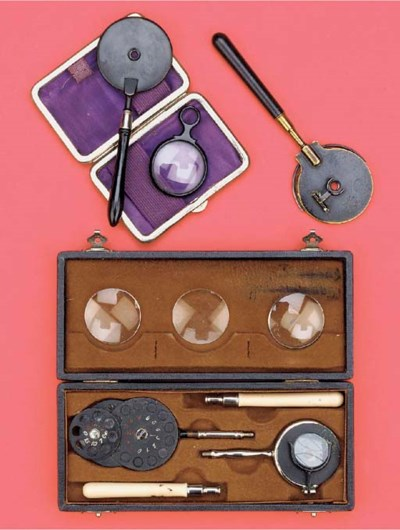 Three ophthalmoscopes,
