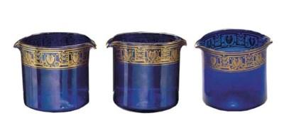 Three blue double-lipped wine-