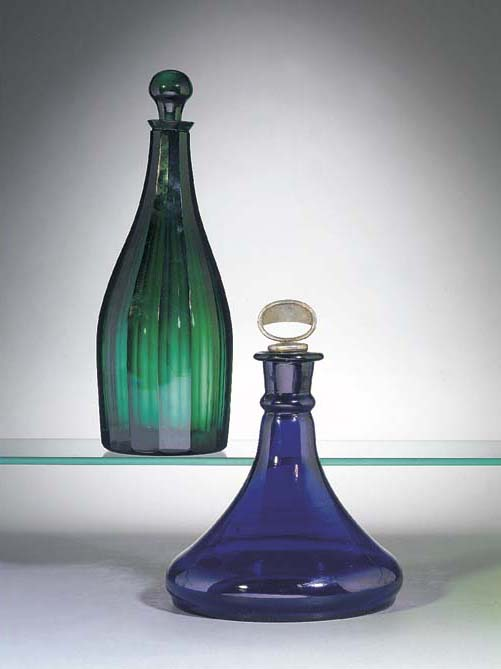 A green glass decanter and a b