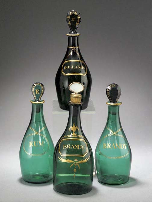Four various green glass decan