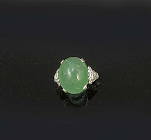 An Art Deco cabochon emerald,