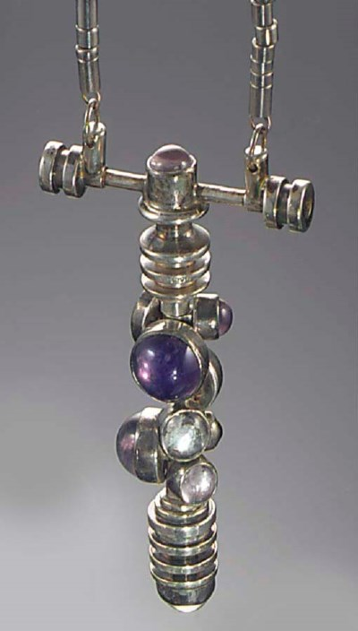 A silver and amethyst pendant